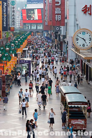 shoppers walking along pedestrianised street, chengdu